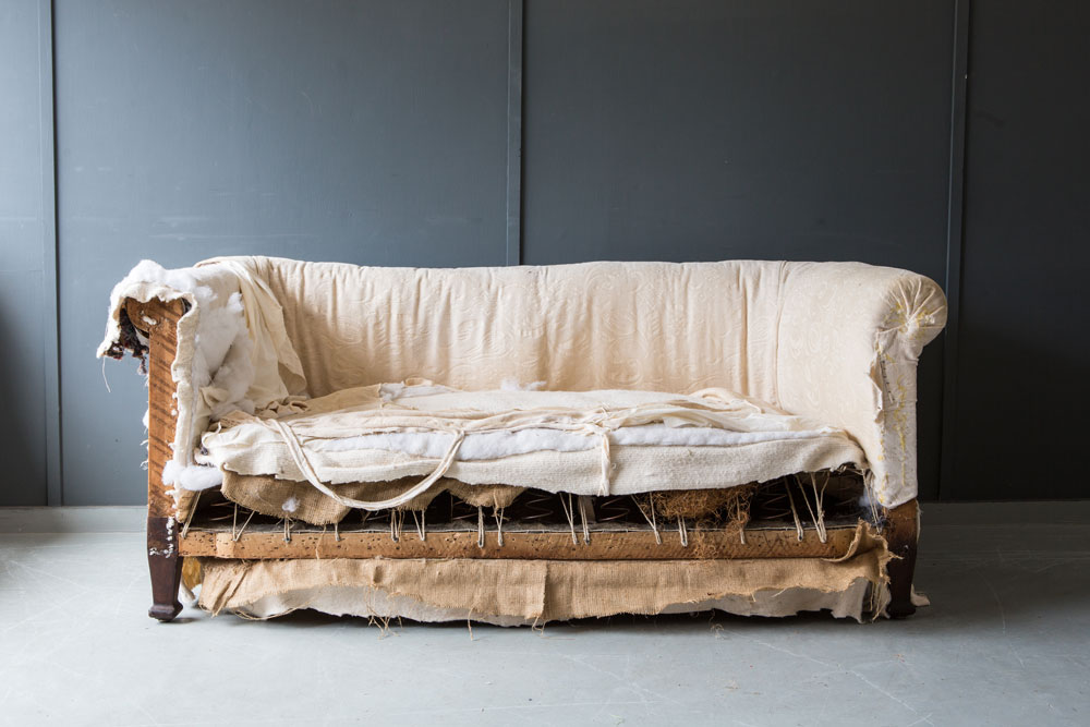 Old Chesterfield sofa prior to being re-upholstered by Vintique Upholstery