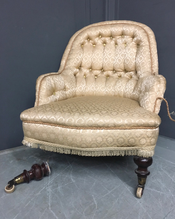 Antique armchair in need of upholstering