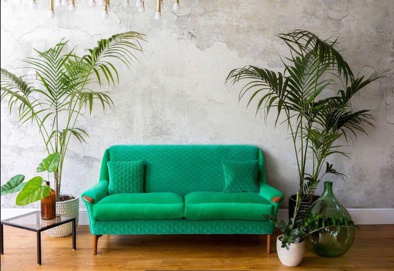 Upholstered vintage sofa in emerald green velvet Kirkby Design fabric