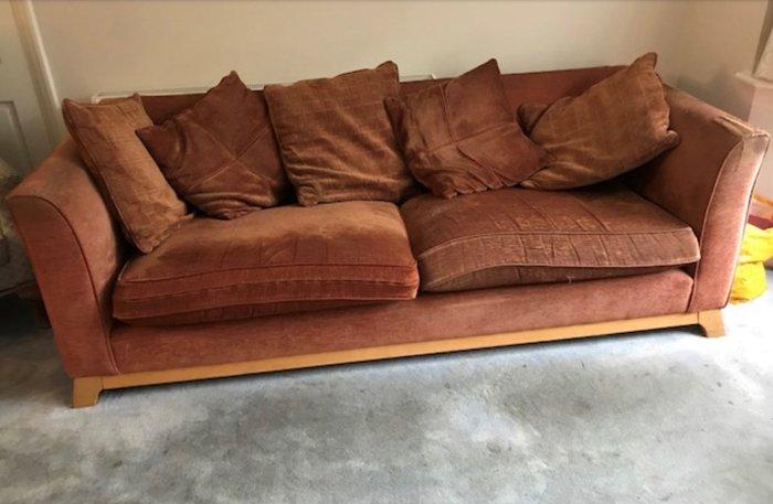 Old brown sofa in need of reupholstering