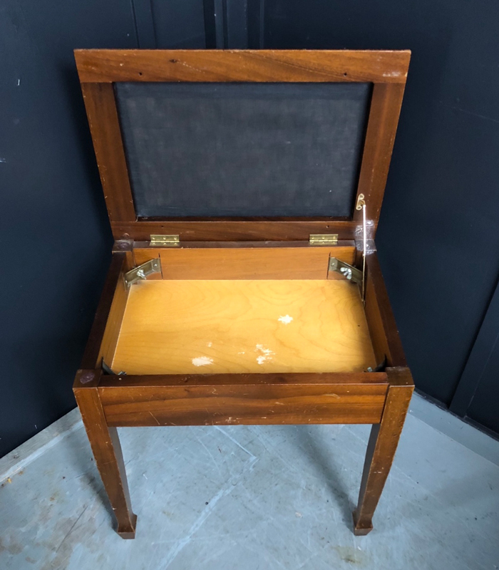 Old vintage piano stool with hidden compartment