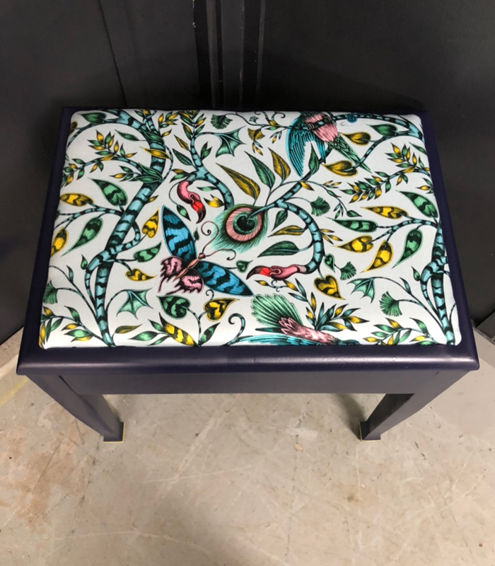 Emma Shipley's Animalia fabric - The Rousseau print in cotton on a piano stool
