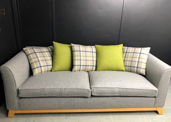Reupholstered sofa in Abraham Moon & Sons fabric