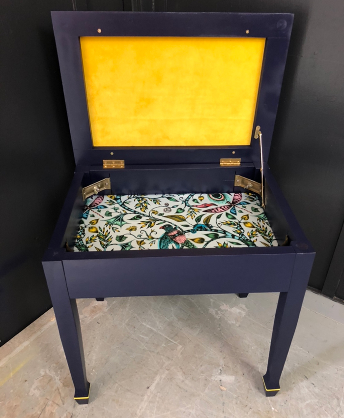 Bright velvet Kirkby Design fabric on piano stool