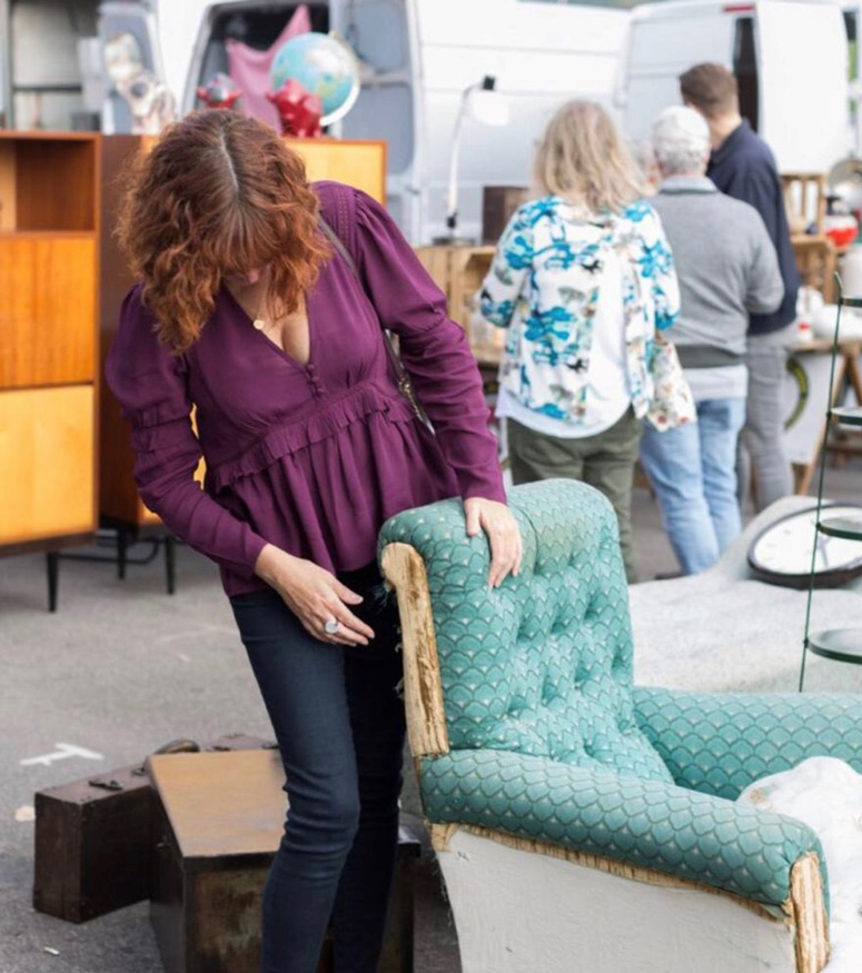 Sharon O'Connor browsing flee market for upholstery projects