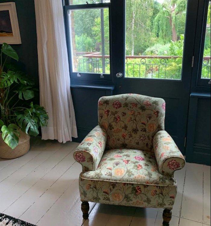 Armchair reupholstered in patterned flower velvet