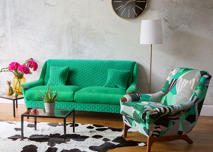 Reupholstered green sofa and patterned armchair