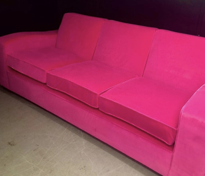 Reupholstered bright pink sofa