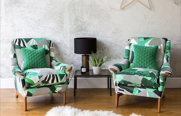 Reupholstered green, black and white armchairs