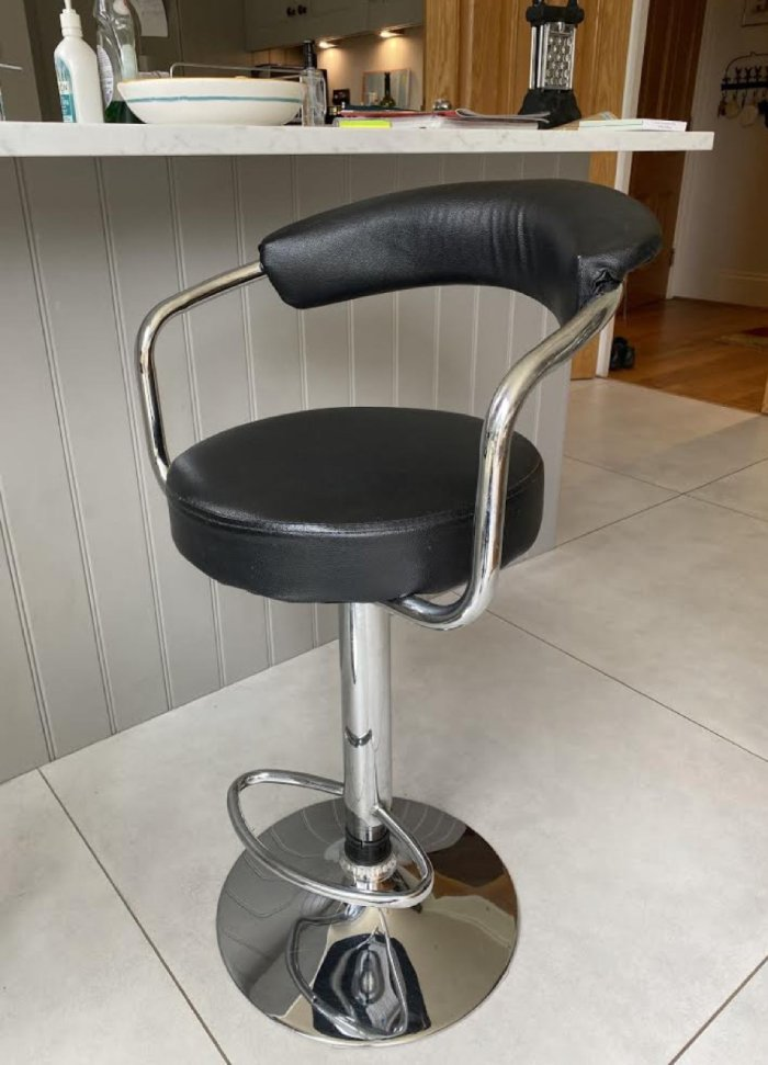 Black leather kitchen stool in need of reupholstering