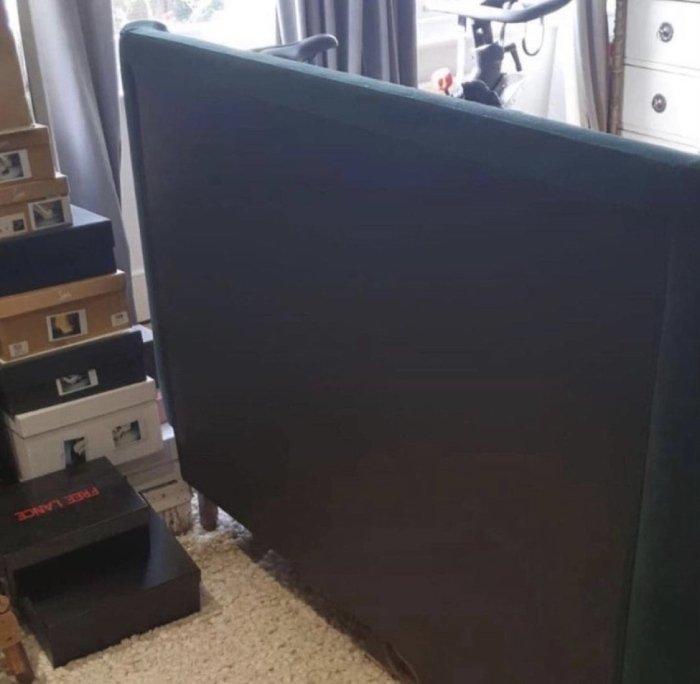 Dark blue headboard in need of reupholstering