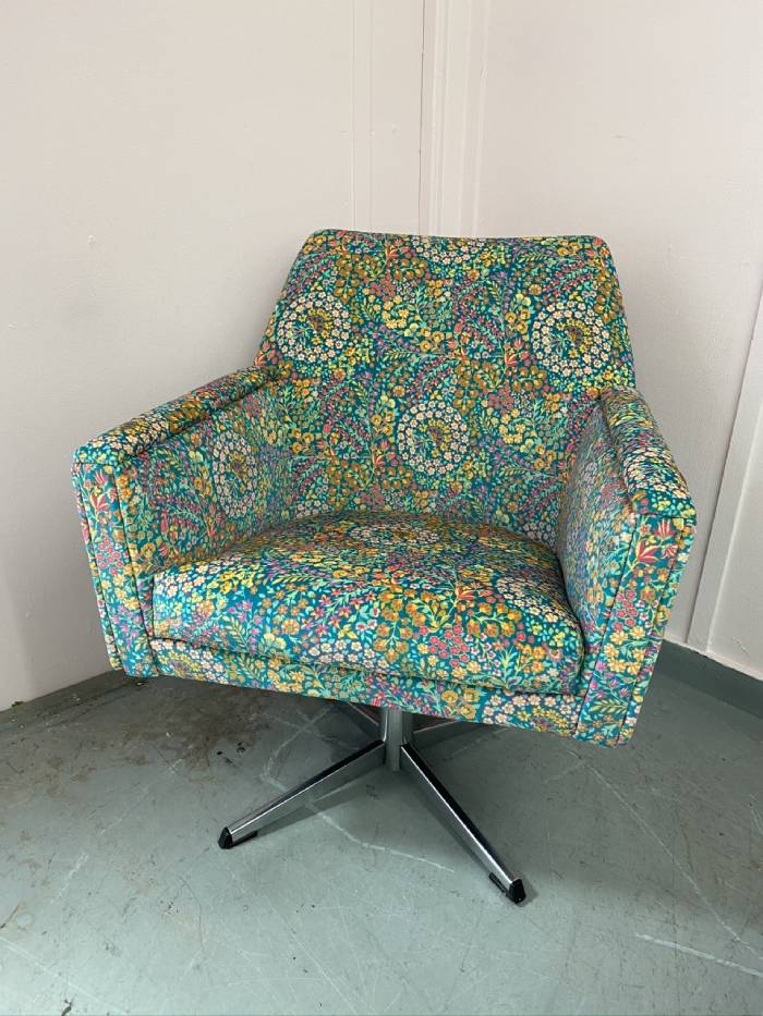 Floral patterned reupholstered armchair