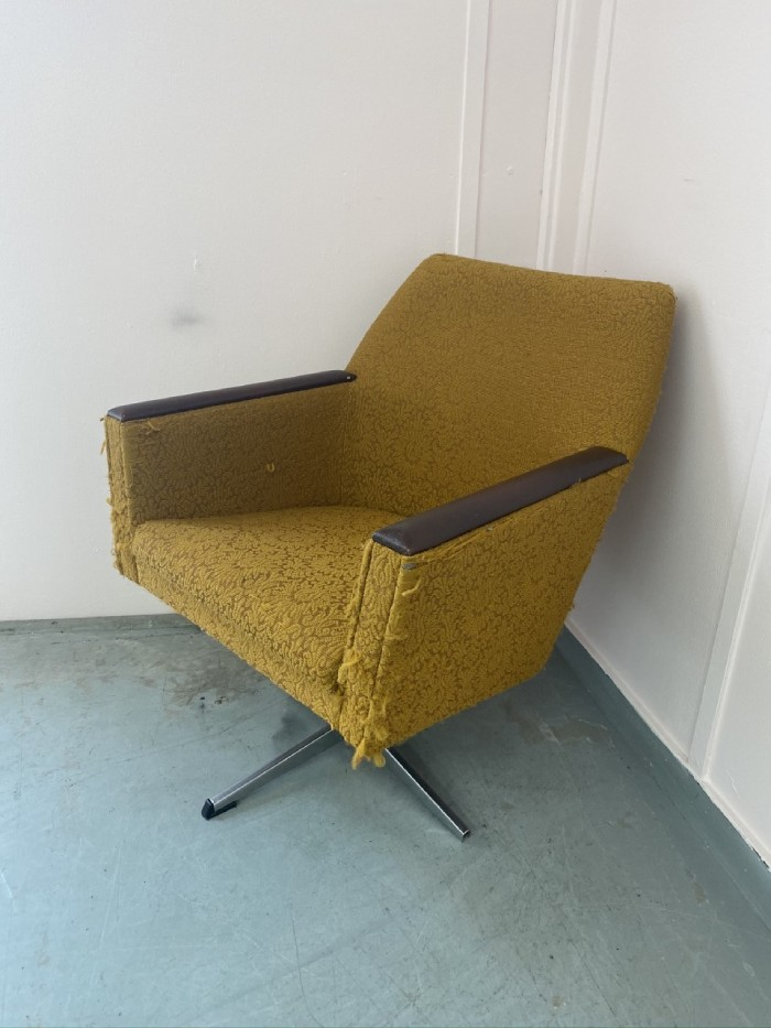 Old yellow armchair in need of reupholstering