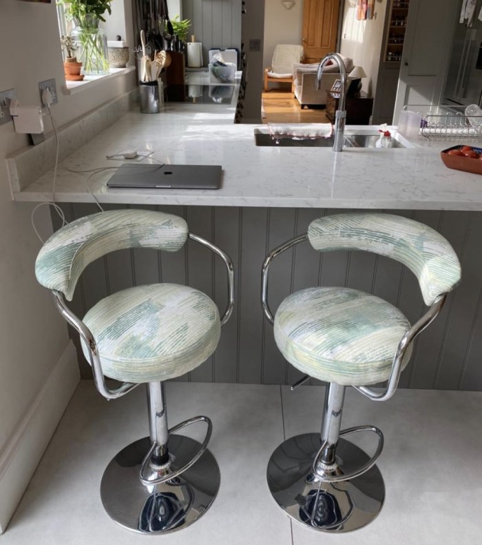 Patterned reupholstered kitchen stools in kitchen